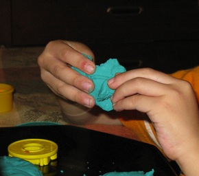 squeezing play dough