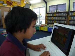 Isaiah working in the school library
