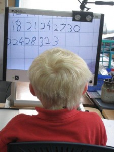 Mitchell completing a maths worksheet under the CCTV