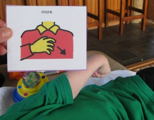 "Kaya lifts her hand towards ""Ask for more"" sign"