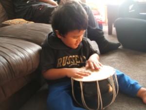 Arama imitates Dolina's drumming