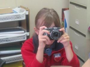 Dulcie using her camera