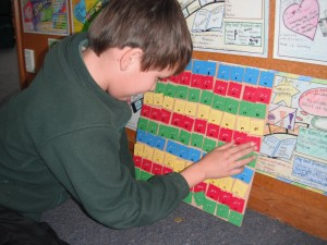Ben using an adapted Hundreds board