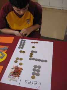 Using play money to learn about value in coins and notes