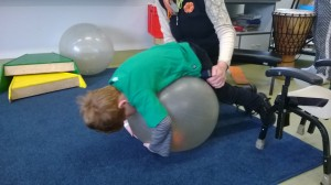 Student rolling over swiss ball